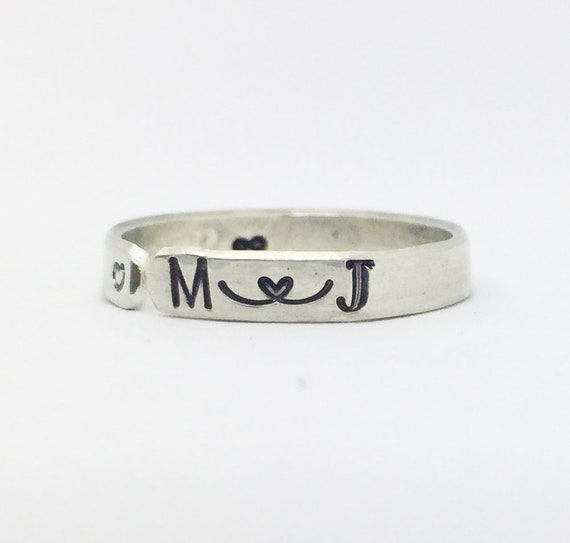 Custom hand stamped silver stacking ring with symbol or initial. Sterling silver personalised ring with charm