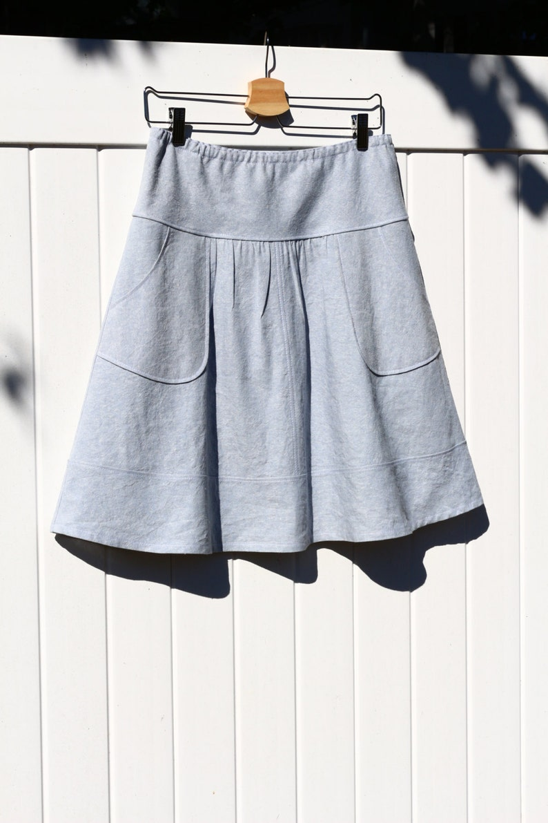 54a483563b9 Light blue Linen blend skirt with Rounded Apron Pockets Semi
