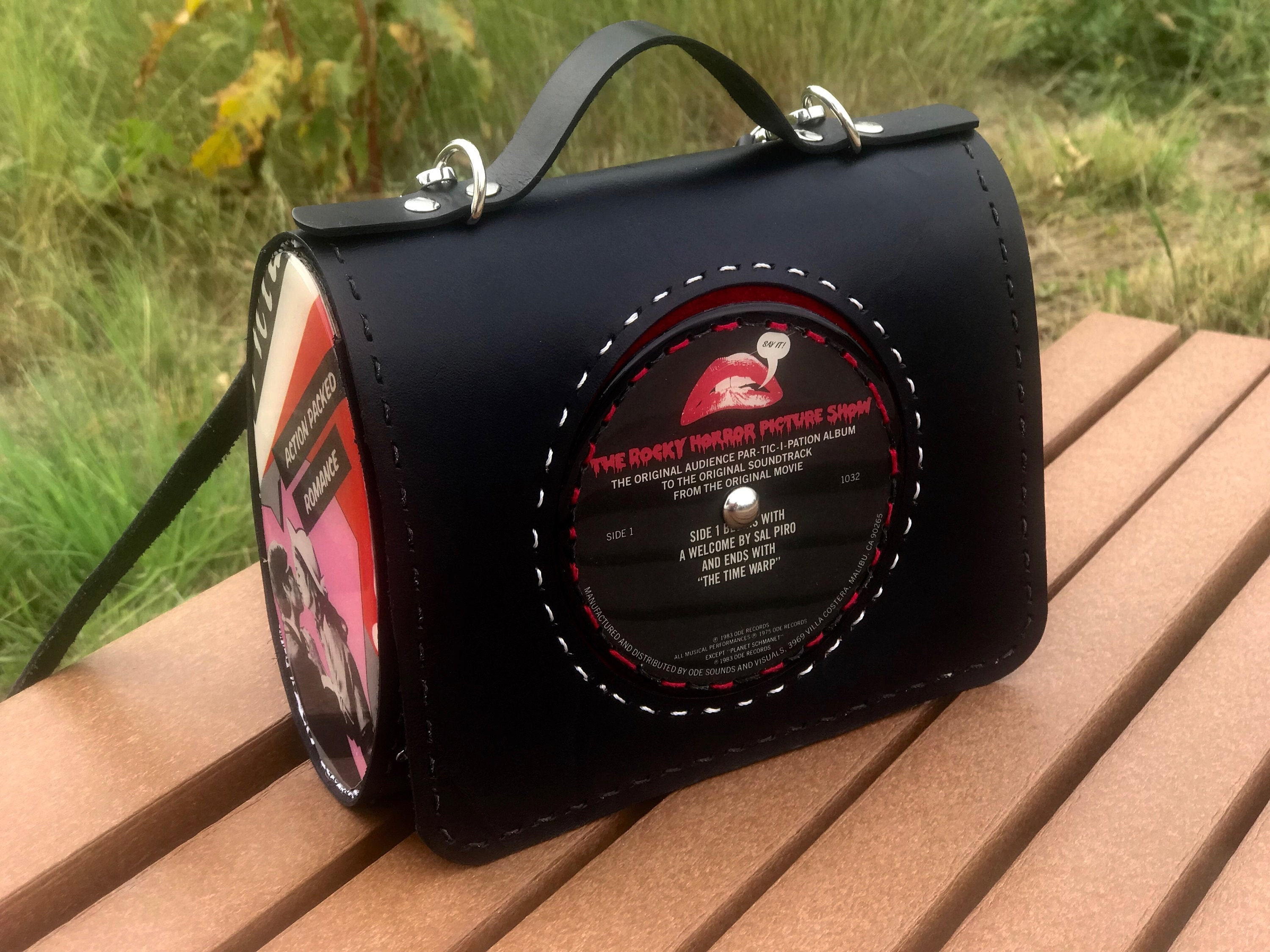 Leather,satchel,crossbody,from,actual,vinyl,record,Rocky,Horror,Picture,Show,Bags_And_Purses,novelty_bag,vindicated_vinyl,recycled_record,vintage_recycle,Clutch,musical_fashion,music_lover_gift,broadway_musical,rocky_horror,soundtrack,time_warp,Halloween_bag,Vinyl record,rivets,resin,eyelets,leather,fabric