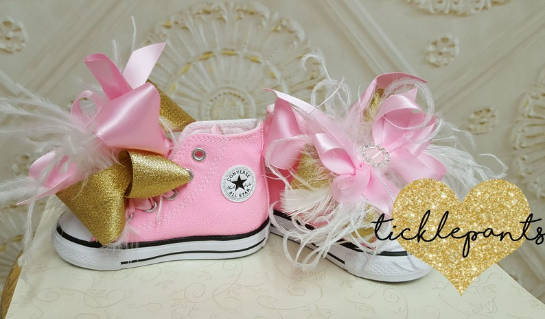 e487672cd4aa Over the top Baby CONVERSE with bows and feathers Made to