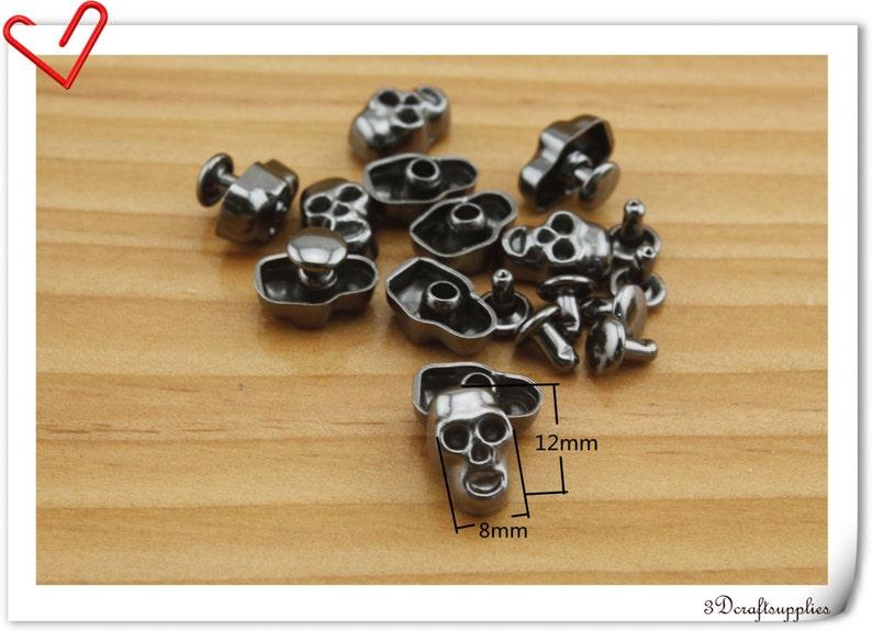 Skull rivets 12mm x 7.5mm  20sets gunmetal    i11