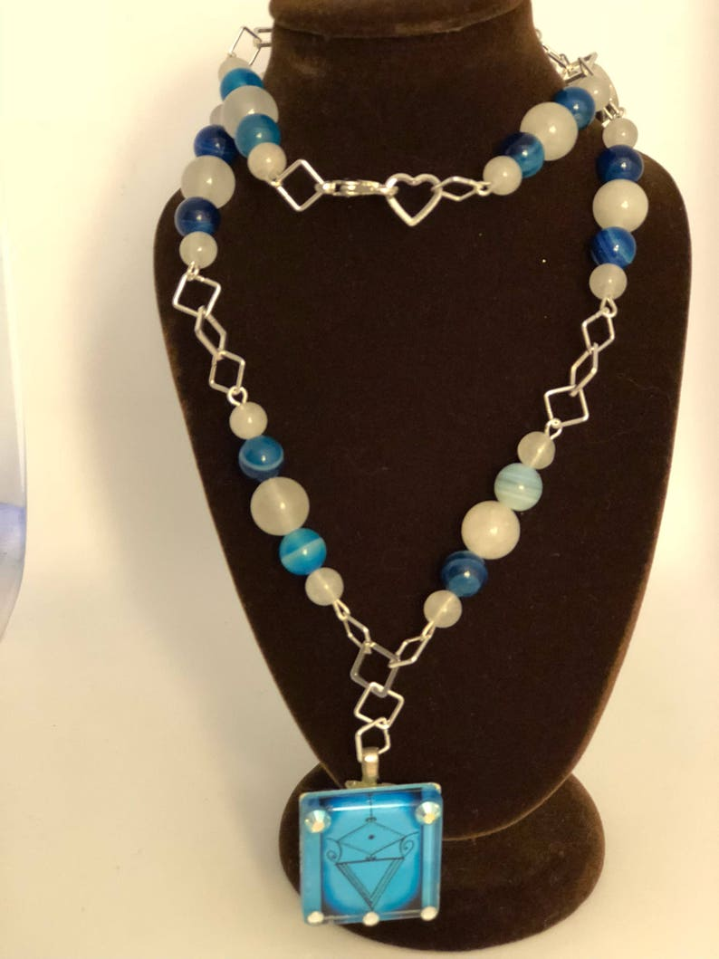 Two accent veve beads adornments. la Sirene Vodou Veve pendant with blue agate and moonstone beaded necklace