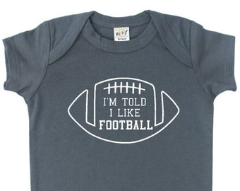 I'm Told I Like Football Graphic Baby Bodysuit