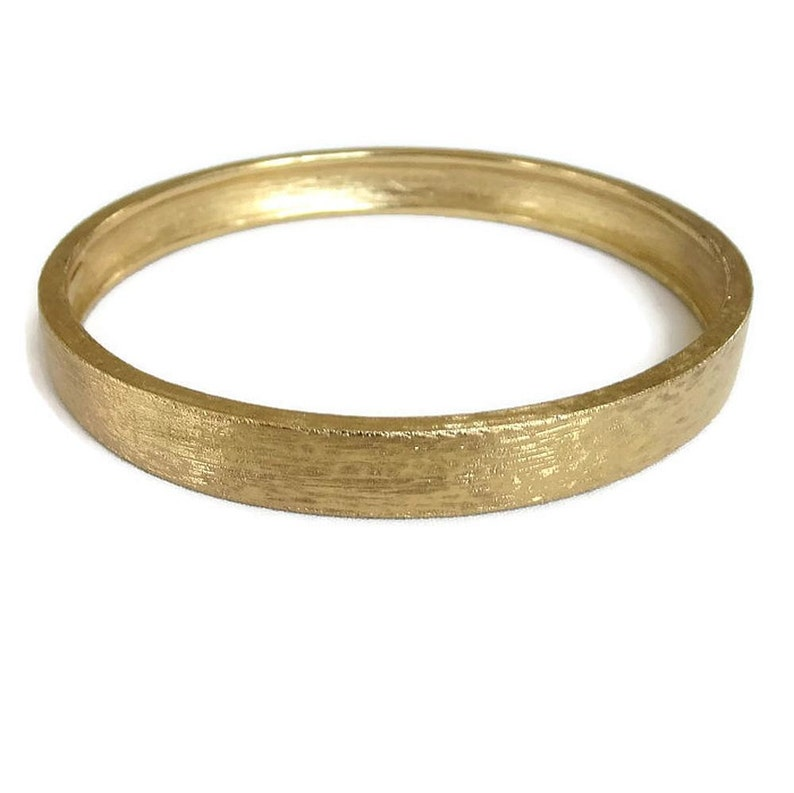 6414f8555e0ed Monet Bangle Bracelet in a Brushed Gold Tone Finish Vintage signed