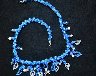 blue pegasus and leaf spiral cord necklace