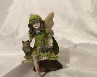 Whimsical fairy girl with cat and rabbit made of resin, excellent for outside. Ready to bring your garden to life with fun and faeries.