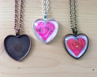 10pk... Heart Pendant Trays...Mix and Match colors...Great for resin or heart glass domes. Size is 25mm...HRTT