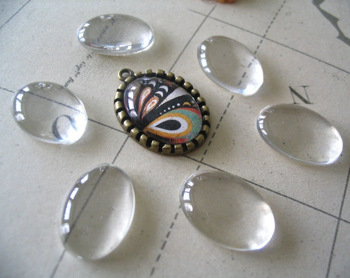 10pk...Size 18x13mm...Oval Glass Tile Cabochon......Great for pendants or earrings.