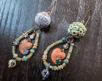 Polymer clay art bead earrings in green and blue