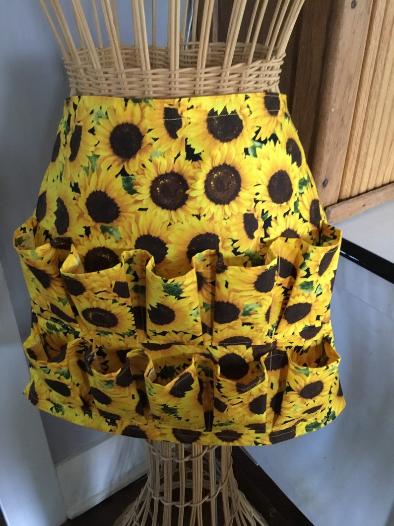 Egg gathering sunflower fabric with pleated pockets