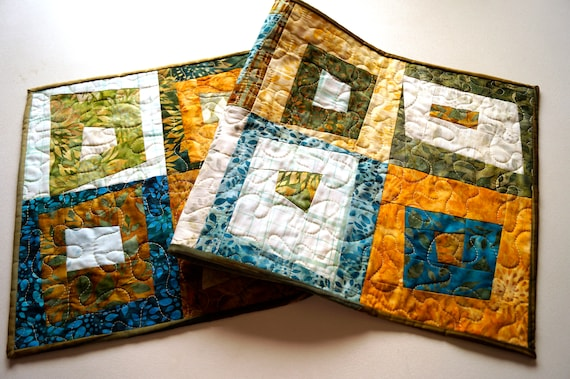 Quilted Batik Fabric Table Runner with Modern Patchwork in Shades of Teal Blue, Green, Orange, Brown and Yellow