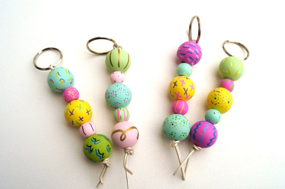 Key Chains with Colorful Hand Painted Wood Beads in Shades of Pink, Blue, Yellow and Green
