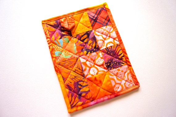 Batik Quilted Fabric Pot Holder with Vibrant Patchwork, Tropical Hot Pad in Orange, Pink and Purple