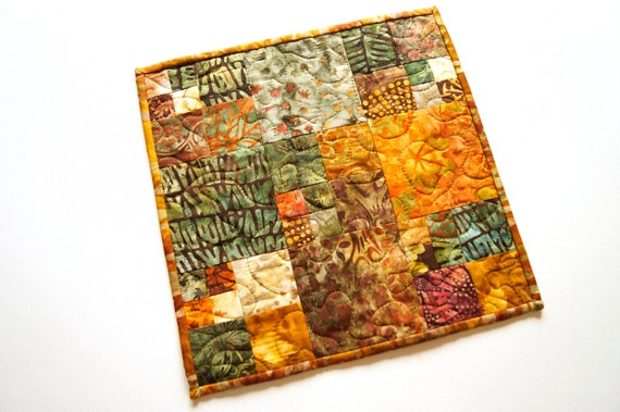 Mini Table Topper with Fall Color Quilted Batik Fabrics. Earth Tone Patchwork Mug Rug