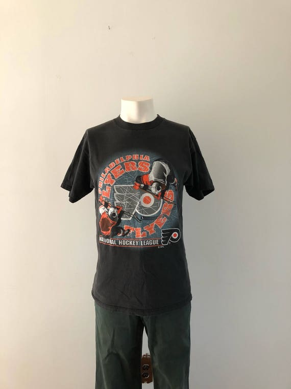 check out 3d6ba 4eded Vintage Philadelphia Tshirt / Philadelphia Flyers / Vintage Hockey Tshirt /  Vintage Philadelphia Flyers Tee / Logo 7 Tee