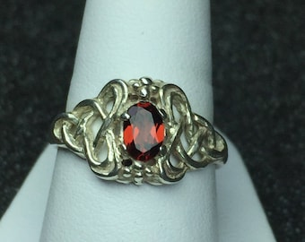 Sterling silver celtic knot ring set with a garnet
