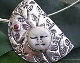 Stunning Ceramic Moon Face on Fine Silver pendant