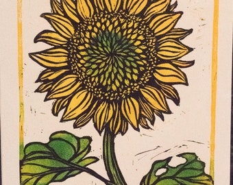 Handprinted lino block print of a sunflower.