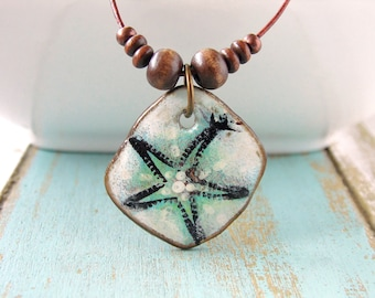 Polymer Clay Jewelry Necklace featuring a Dancing Starfish Grunge Beach Boho Design in Teal, Black and White