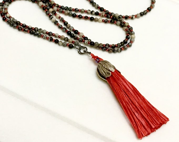 Featured listing image: Long Beaded Chain with Red Handmade Silk Tassel, Color Pop, Wrap Chain, Original Black & Gray Stone Necklace, Boho Trend, Mala Inspired