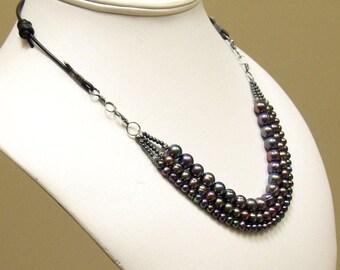 Multi Strand Peacock Pearl and Black Leather Necklace, Modern Dark Pearl Bib, Artisan Original Pearl Jewelry Design, Pearls on Black Leather