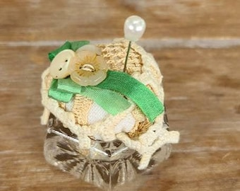 Vintage laces and linens pin keeper artisan crafted vintage vessel Ribbon lace and buttons in green caster
