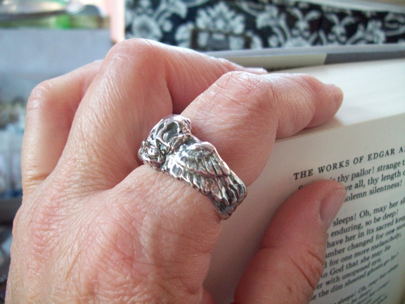 winged skull wraps your finger fine silver artisan hand image 0