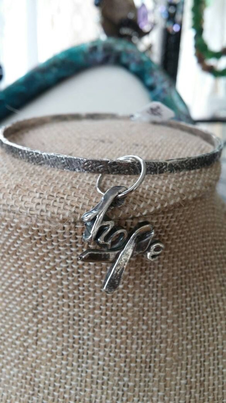 fine silver statement of hope dangles from silver bangle image 0