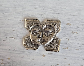 One - reclaimed fine silver threadminder - abstract face - thread winder