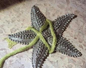One - reclaimed fine silver threadminder - textured starfish - thread winder