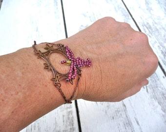 Beaded bird on felegree bracelet
