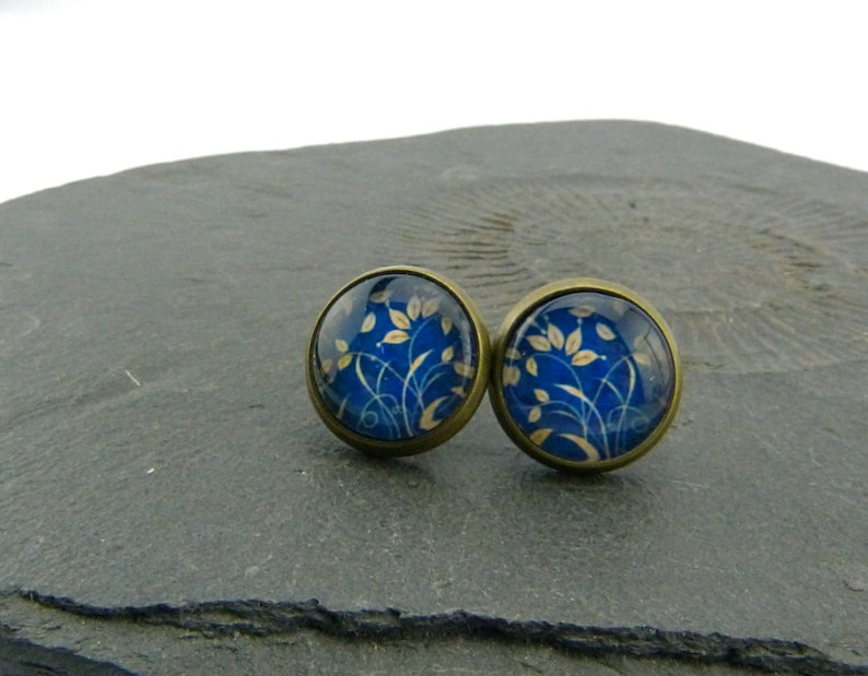 12 mm poetic glass cabochon ear posts Delicate grass and leaves waving in the wind set in antiqued brass blue and beige nickelfree