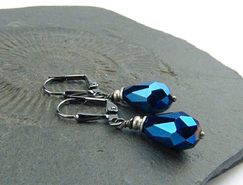 sparkly and feminine. Blue Sparkle Drops Shiny Faceted Glass Drop Earrings with silver accent and gunmetal french earwires
