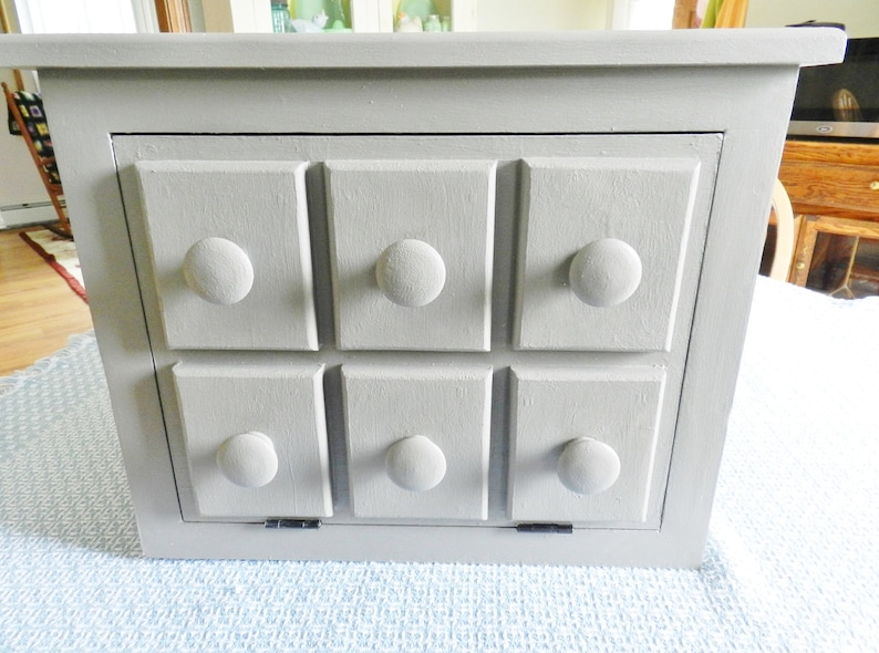 Look how cute this little cupboard is! Something that fits right on your countertop and looks super cute can hide that old toaster oven or coffee maker. Here are some tips and tricks to hide your small appliances.