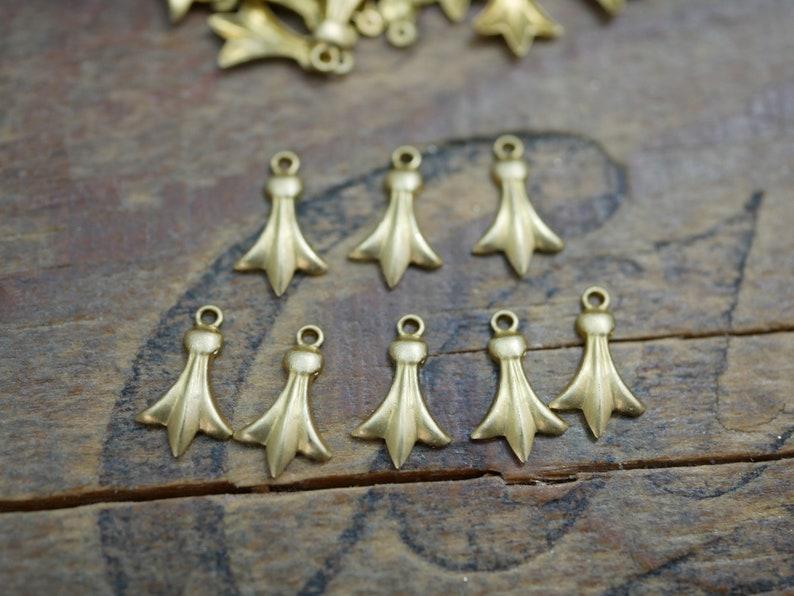 #06733 8 pieces Small Brass Drop Dangle Fleur De Lis Drop 12x6mm  Made in the USA