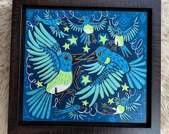 Bluebird woodcut framed in solid tiger maple wood