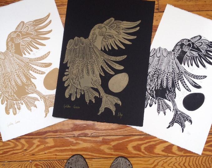 Golden Goose linocut, gold ink on black paper