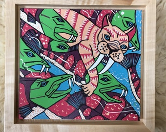 Sabretooth cat and trout woodcut framed in solid tiger maple wood