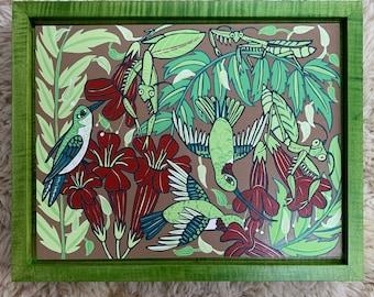 Hummingbird and praying mantis woodcut framed in green