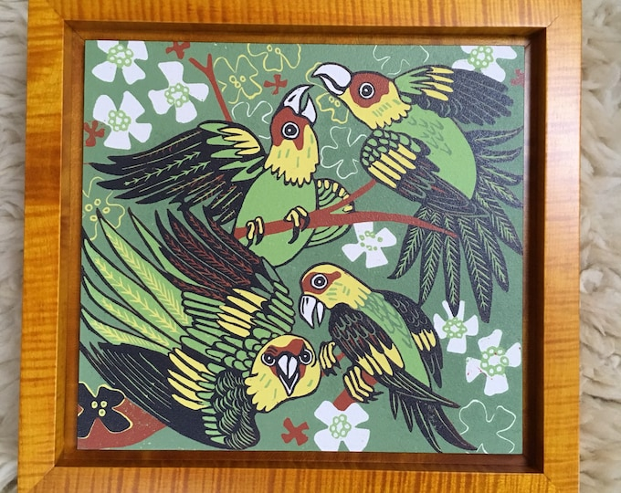 """Carolina Parakeet"" woodcut framed in solid tiger maple wood"