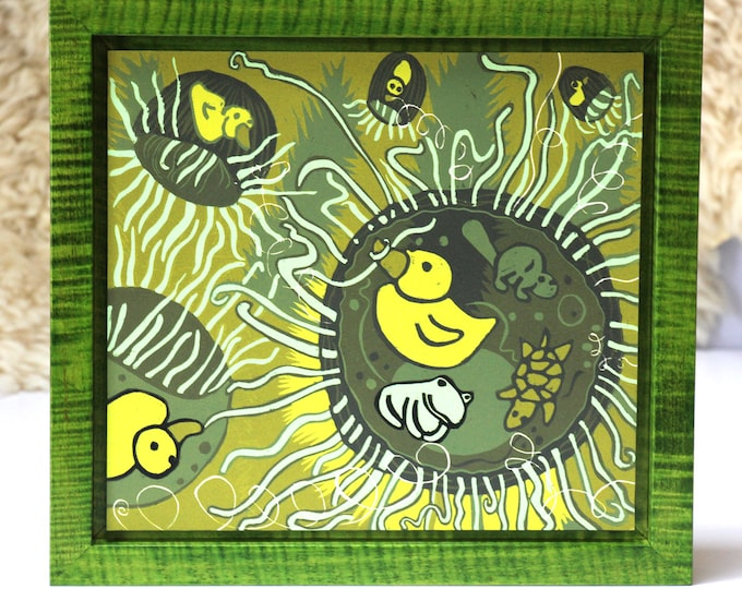 Jellyfish and Rubber Duck woodcut framed in solid tiger maple wood