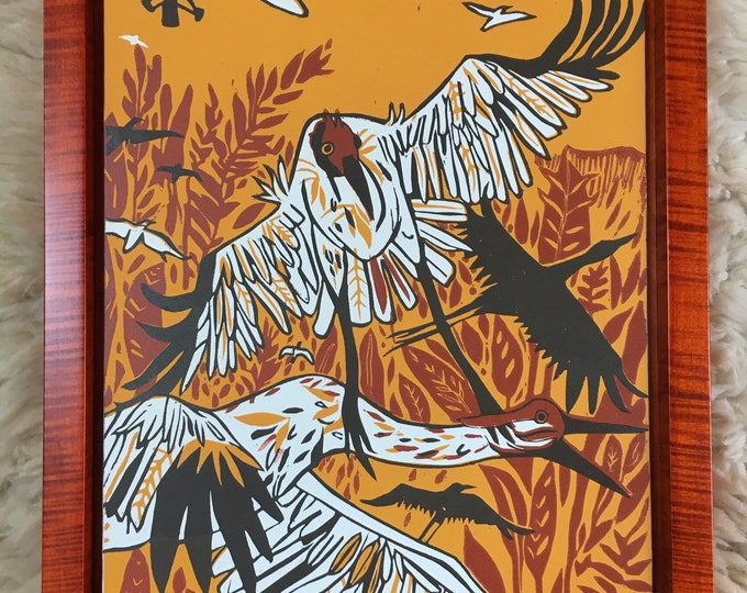Whooping Crane woodcut and moon framed in orange tiger maple