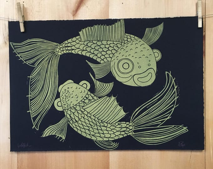 Goldfish original linocut on black paper