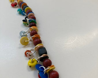 """Treasure Necklace - 27"""" with 51 charms of wire-wrapped wood, Czech glass, African  vulcanite-vinyl& lamp work charms"""