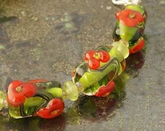 Green and red floral handmade lampwork glass bead bracelet