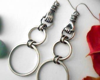 three hoop earrings, sterling silver, elegant hoops, vintage inspired hoop earrings, hands holding hoops, hand earrings, hoops with hands