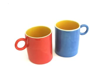 two hand built porcelain petite cups  ...   festive red  yellow  and blue   ...   set of short  cups