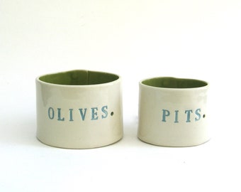 olives and pits   ...  hand built porcelain containers ...  serving pieces