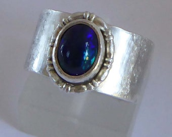 Blue flash Welo Opal set in wide silver ring size O 71/4