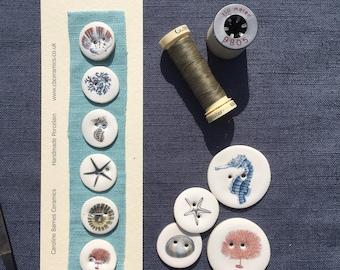 Set if 6 seaside porcelain buttons 2.3cm diameter.
